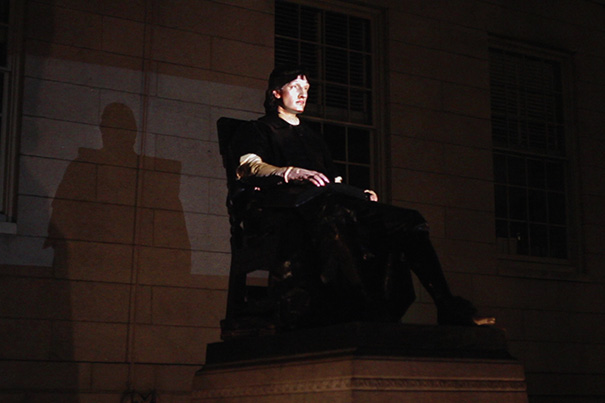 As part of public art project, students help to animate Harvard's iconic campus statue.