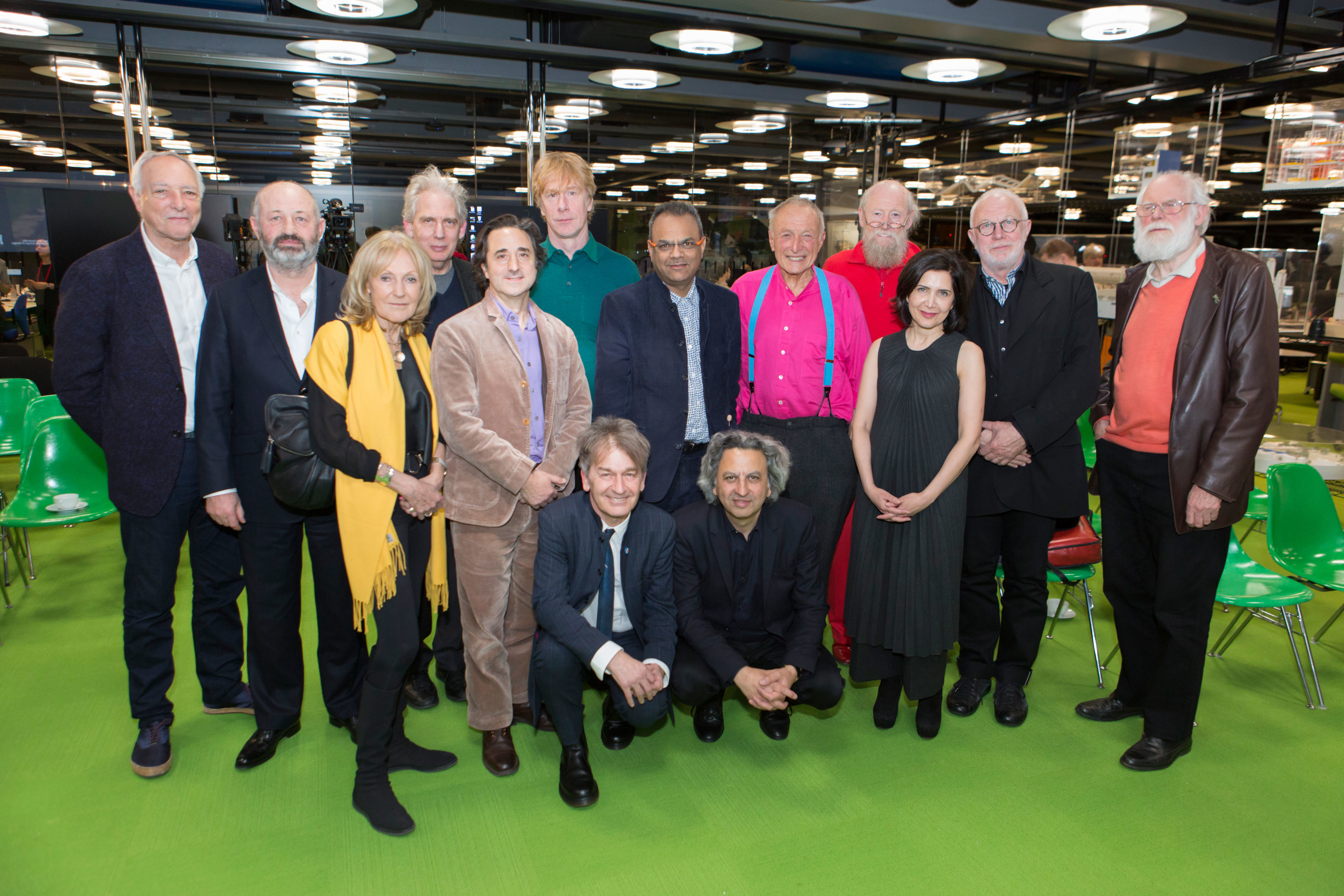 London: Collaboration: The Lineage of an Architectural Practice (left to right standing): Chris Wilkinson, Andrew Morris, Eva Jiřičná, Ricky Burdett, Philip Gumuchdjian, Ivan Harbour, Hanif Kara, Richard Rogers, Mike Davies, Farshid Moussavi, K. Michael Hays, and Laurie Abbott. (left to right squatting): Graham Stirk and Dean Mohsen Mostafavi.