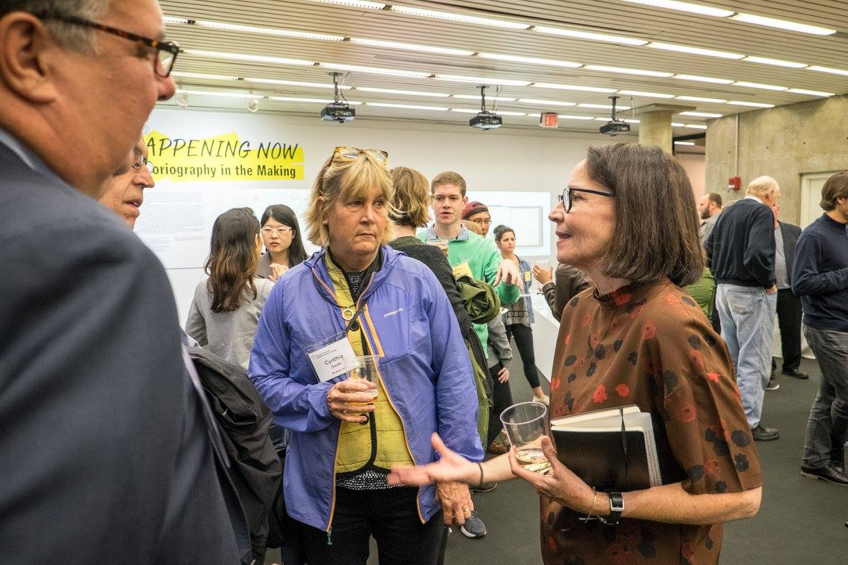 Alumni, students, faculty, and staff gathered for a reception hosted by Anita Berrizbeitia MLA '87, professor of landscape architecture and chair of the Department of Landscape Architecture (right), before the Olmsted Lecture from Peter Latz.