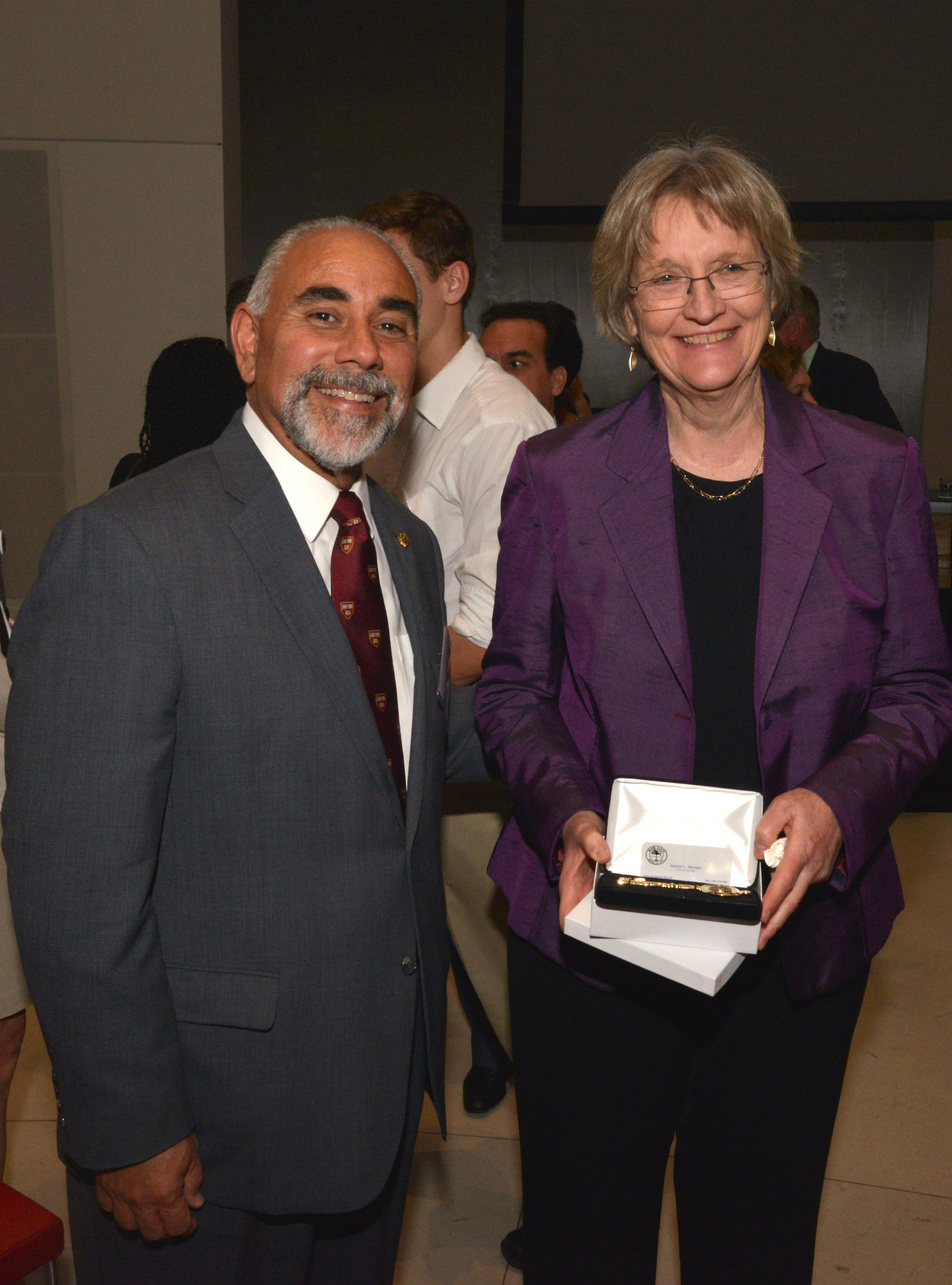 Jimmy Morales, City Manager at City of Miami Beach with Drew Gilpin Faust, President and Lincoln Professor of History, Harvard University.