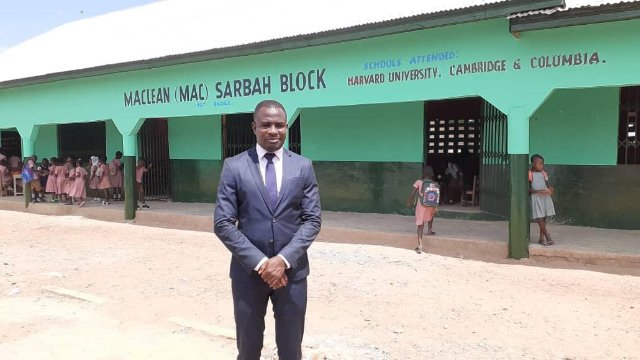 Mac Sarbah in front of the Yeji Royal Educational Complex